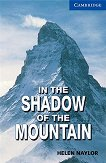 Cambridge English Readers - Ниво 5: Upper - Intermediate : In the Shadow of the Mountain - Helen Naylor - книга